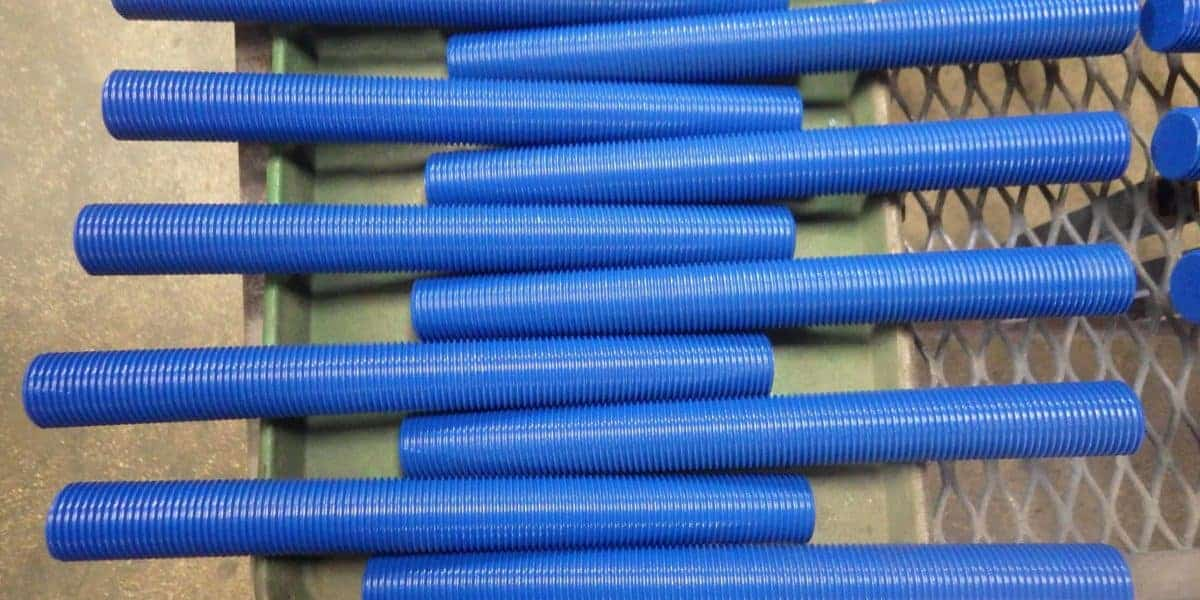 Several Teflon-coated (PTFE coated) stud bolts, all blue in color.